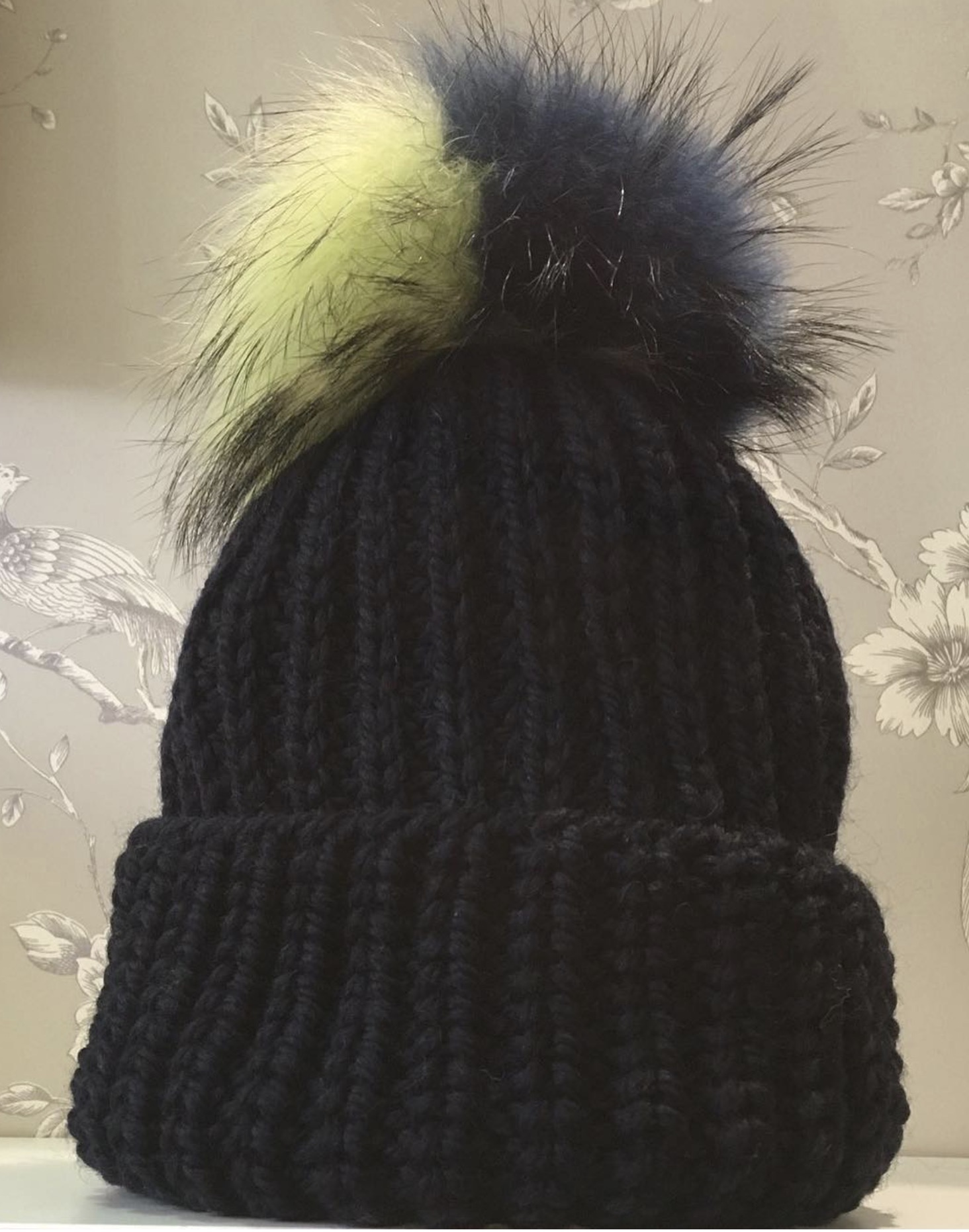 ce6a7cdc957 img 0269. img 0269. £49.00 £39.20. Description  SizeChart. Gorgeous Fenella  knitted bobble hat with a Raccoon Fur Pom Pom.